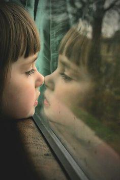 kid in window
